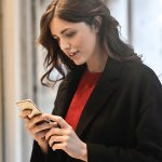 close-up-photo-of-woman-in-black-coat-using-smartphone-787929-600